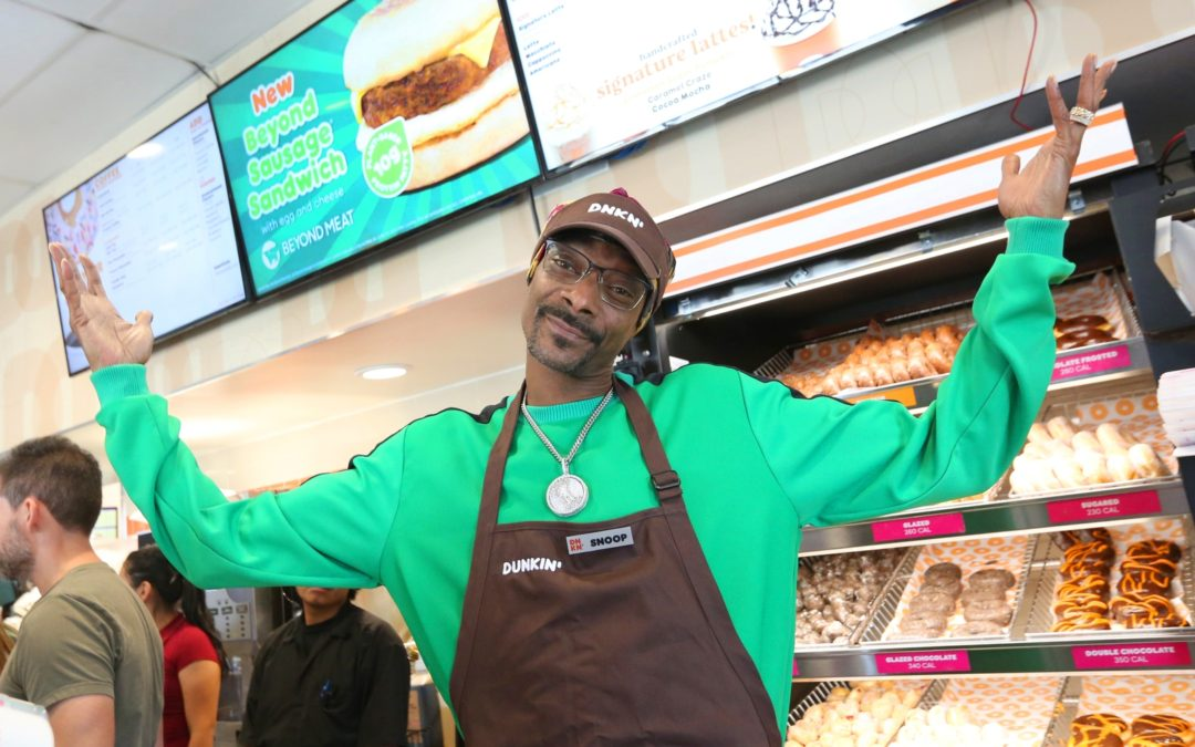 Snoop Dogg made a sandwich for Dunkin' and it comes with a donut bun.
